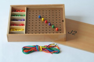 wooden pegs and board