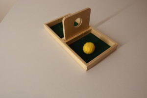 Imbucare board with knit ball